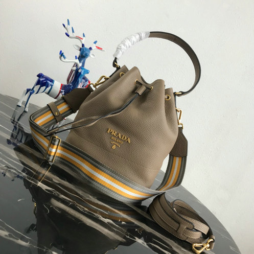 2019 Prada Leather Bucket Bag with multicolored fabric shoulder strap